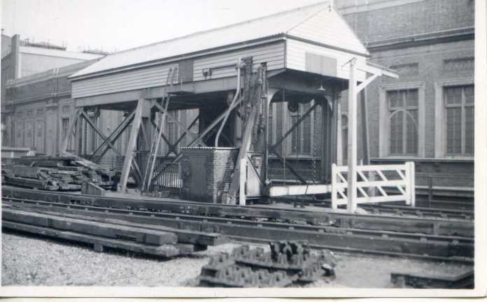 Armstrong Lift for the Waterloo & City Line rolling stock. As the line had no connection to any other line, nor any ground level section, it was necessary to provide a hoist to bring the passenger cars to the line, and to get them out for heavy maintenance. Photo undated but probably late 1950s.